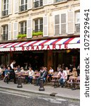 Small photo of Paris, France - September 1, 2016: Tourists in Le Bonaparte café. Le Bonaparte is one of the finest cafes of Saint-Germain des Prés.