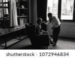 the bride is doing makeup.... | Shutterstock . vector #1072946834