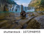 waterfall and rock | Shutterstock . vector #1072948955