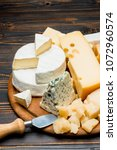 various types of cheese   brie  ... | Shutterstock . vector #1072960574