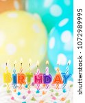 colorful candles for birthday... | Shutterstock . vector #1072989995