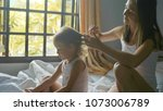 mother enjoying time with her... | Shutterstock . vector #1073006789