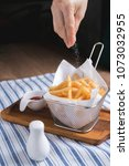 favoring french fried with salt ... | Shutterstock . vector #1073032955