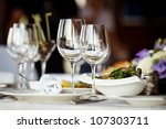 empty glasses set in restaurant | Shutterstock . vector #107303711