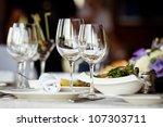 empty glasses set in restaurant   Shutterstock . vector #107303711