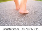 walking foot on the asphalt. | Shutterstock . vector #1073047244