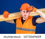 man in protective gloves holds... | Shutterstock . vector #1073069609