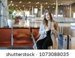 european pretty girl using... | Shutterstock . vector #1073088035