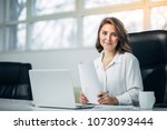 young woman working in office   Shutterstock . vector #1073093444