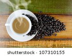 Top view of coffee cup on the vintage wood table - stock photo