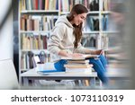 young female student studying... | Shutterstock . vector #1073110319
