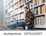 young female student studying... | Shutterstock . vector #1073110337