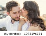 a beautiful young couple is... | Shutterstock . vector #1073196191