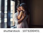 young couple hugging by the... | Shutterstock . vector #1073200451