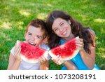 smiling kids eating watermelon... | Shutterstock . vector #1073208191
