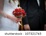 red roses in brides hands   Shutterstock . vector #107321765