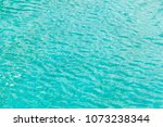 the green water reflects the... | Shutterstock . vector #1073238344