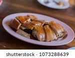 suckling pig asian food | Shutterstock . vector #1073288639