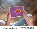 woman sitting on the floor with ... | Shutterstock . vector #1073338409