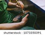 experienced footwear industry... | Shutterstock . vector #1073350391