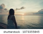 silhouette of young woman... | Shutterstock . vector #1073355845