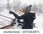 two girls walk on a snowy day | Shutterstock . vector #1073362871