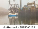 Lobster Boat In The Fog By A...