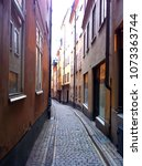 narrow colorful alley at... | Shutterstock . vector #1073363744