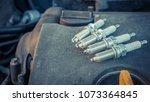 replacing spark plugs in the car | Shutterstock . vector #1073364845