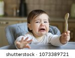 crying hungry little baby with... | Shutterstock . vector #1073389721
