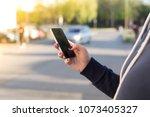 girl calling a taxi car | Shutterstock . vector #1073405327