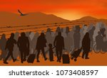 silhouettes of refugees people... | Shutterstock .eps vector #1073408597