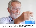 scientist with a test tube. | Shutterstock . vector #1073437535