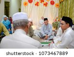 Small photo of JELEBU, MALAYSIA - April 19th, 2018 : A muslim couple getting solemnization . Malay Traditional Wedding. In a islamic wedding the most important thing is the Nikah ceremony.