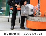 luggage wrapping service at the ... | Shutterstock . vector #1073478785
