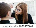make up artist work in her... | Shutterstock . vector #1073507441