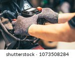 motorcycle mechanic replaces a... | Shutterstock . vector #1073508284
