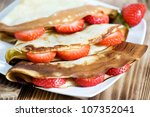 pancake with strawberry on the... | Shutterstock . vector #107352041