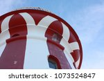 stripe light house on a sunny... | Shutterstock . vector #1073524847