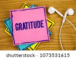 Small photo of Conceptual hand writing showing Gratitude. Business photo showcasing Quality of being thankful Appreciation Thankfulness Acknowledge written on Sticky Note Paper on wooden background Handsfree.