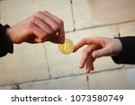 golden bitcoin is passed from...   Shutterstock . vector #1073580749