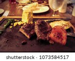 unfinished dinner of steak with ... | Shutterstock . vector #1073584517