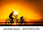 sporty friends on bicycle on... | Shutterstock . vector #1073592134