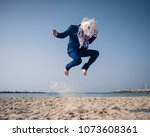 stylish man in funny mask and... | Shutterstock . vector #1073608361