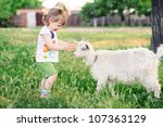 A Little Girl With A Goat