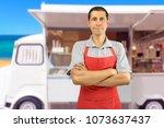 smiling ice cream car employee... | Shutterstock . vector #1073637437