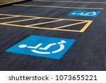 handicap parking icon on... | Shutterstock . vector #1073655221