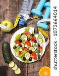 healthy eating  vegetable salad | Shutterstock . vector #1073664014