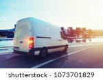 van run fast on the highway to... | Shutterstock . vector #1073701829