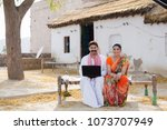 a rural couple sitting on the... | Shutterstock . vector #1073707949